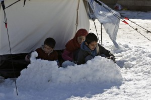 Syrian refugee children play in the snow which turned deadly. during Christmas, 2013 seven children froze to death in just one UN refugee camp.