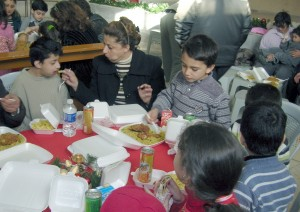 Some of the many Children at the very first Christmas for Refugee dinner receive food and some Christmas joy