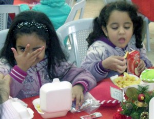 Christian girls enjoy a Christmas meal rather than slavery under radical Islam