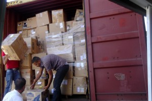 Container of supplies being unloaded for distribution to Christian refugees in Jordan (August, 2014)
