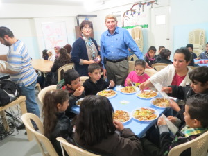 Alia Abboud of the Lebanese Society for Educational and Social Development and William J. Murray in the midst of the children.