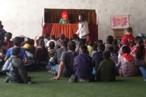 Children watch puppet show explaining the true meaning of Christmas - the coming of Jesus Christ