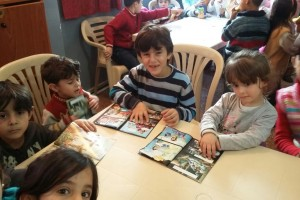Children enjoy their Bible workbooks at a previous Christmas event.