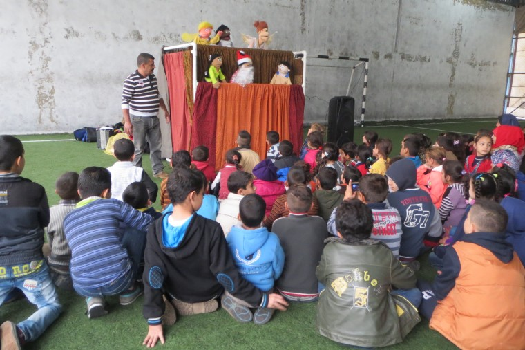 A puppet show as used to explain the purpose of the coming of theJesus Christ