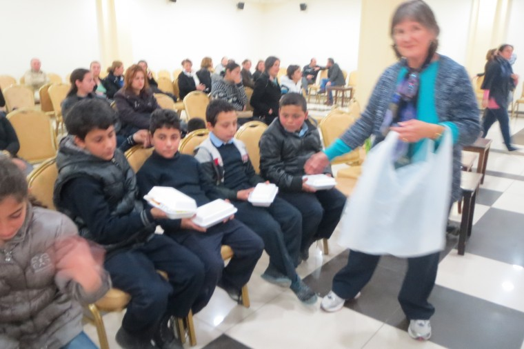 Nancy Murray helps to distribute meals to the nearly 150 children at this event