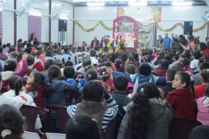 Children react as clown performer announces entrance of another character. More than 300 children attended this event