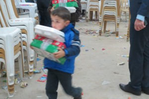A lot of goodies for one little Iraqi boy as he leaves to go back to camp