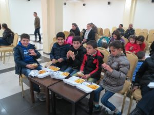 Children in Jordan enjoying their meals.