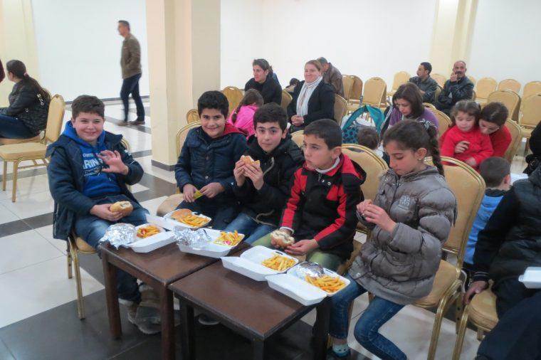 Children in Jordan enjoying their meals.